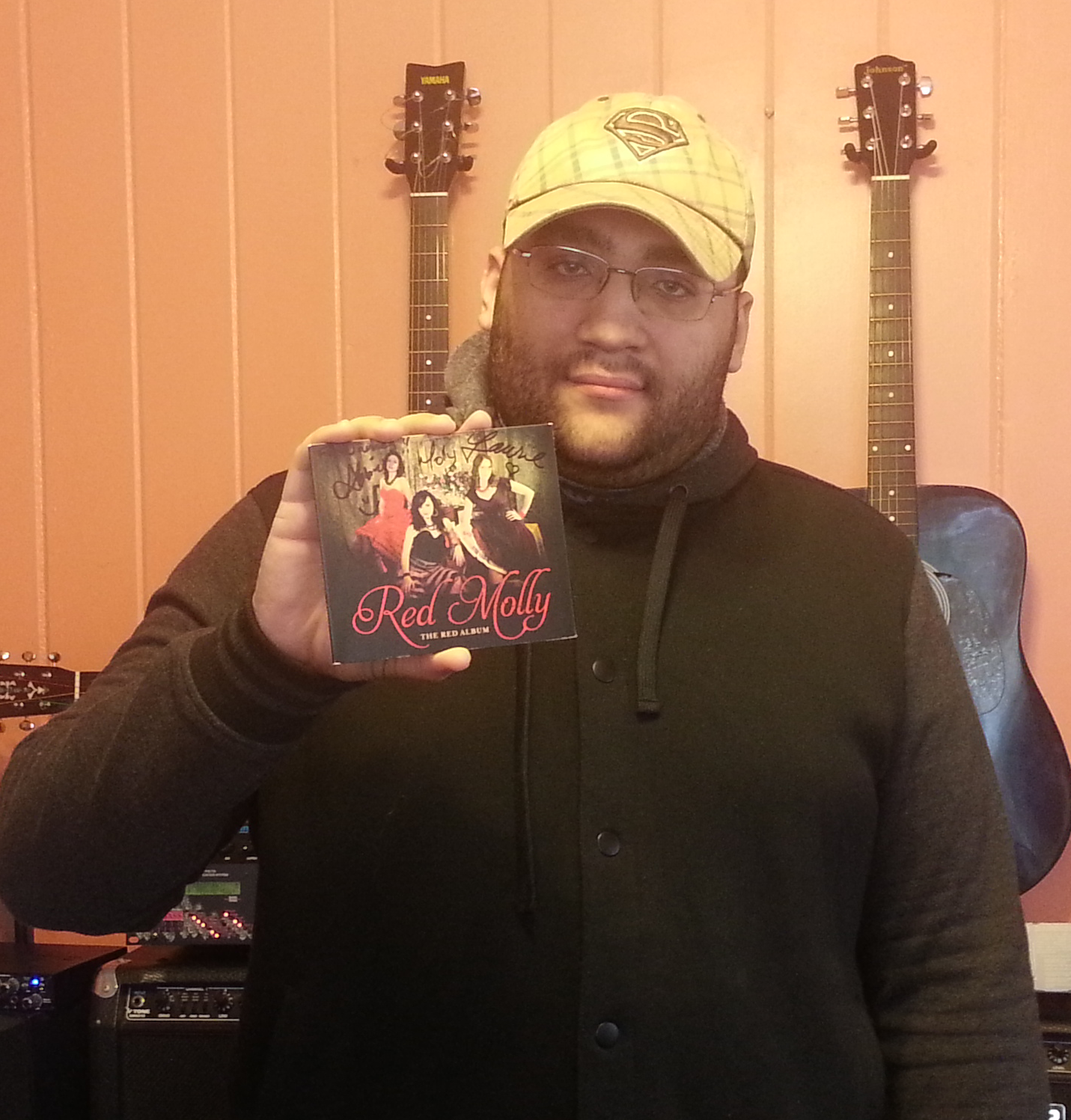 Holding my autographed copy of The Red Album